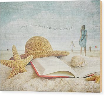 Straw Hat And Book In The Sand Wood Print by Sandra Cunningham