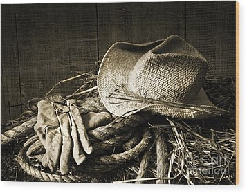 Straw Hat With Gloves On A Bale Of Hay Wood Print by Sandra Cunningham