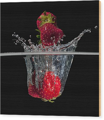 Strawberries Splashing In Water Wood Print