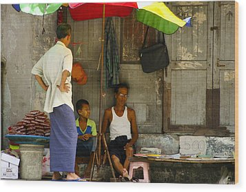 Street Seller Sitting In The Shade Under An Umbrella Yangon Myanmar Wood Print by Ralph A  Ledergerber-Photography