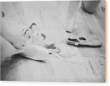Students Putting On Pointe Shoes At A Ballet School In The Uk Wood Print by Joe Fox