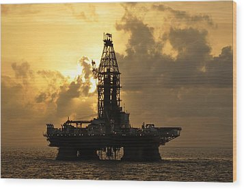 Wood Print featuring the photograph Sun Behind Oil Rig With Clouds by Bradford Martin