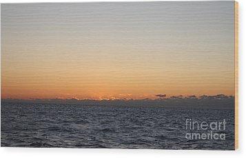 Sun Rising Above Clouds And Horizon Wood Print by John Telfer