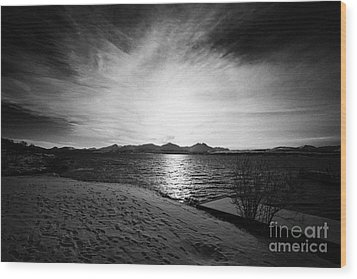 sun setting with halo over snow covered telegrafbukta beach Tromso troms Norway europe Wood Print by Joe Fox