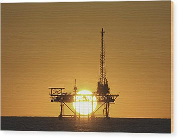Wood Print featuring the photograph Sunset Behind Oil Rig by Bradford Martin