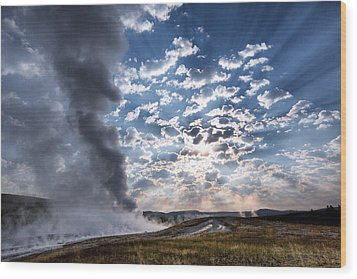 Sunset Over Old Faithful - Horizontal Wood Print by Andres Leon