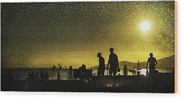 Wood Print featuring the photograph Sunset Silhouette Of People At The Beach by Peter v Quenter