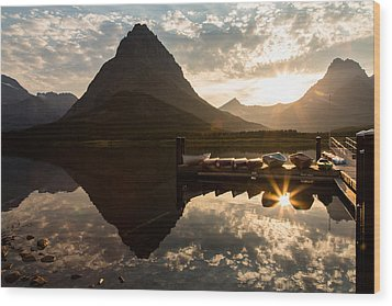Swiftcurrent Lake Boats Reflection And Flare Wood Print by John Daly