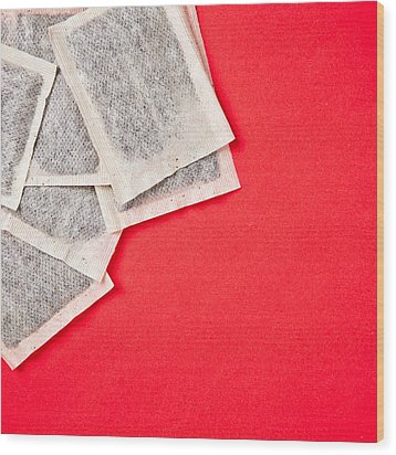 Tea Bags Wood Print by Tom Gowanlock