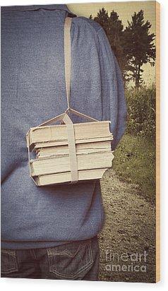 Teen Boy's Back With Books Wood Print by Edward Fielding