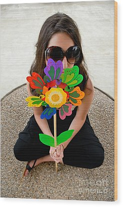 Teenage Girl Hiding Behind Toy Flower Wood Print by Amy Cicconi
