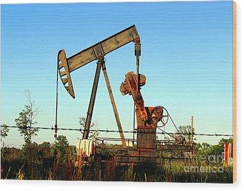 Texas Pumping Unit Wood Print by Kathy  White