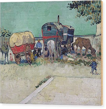 The Caravans   Gypsy Encampment Near Arles Wood Print by Vincent Van Gogh