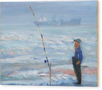 The Fishing Man Wood Print by Michael Daniels