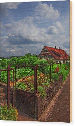 The Garden Gate Wood Print by Debra and Dave Vanderlaan