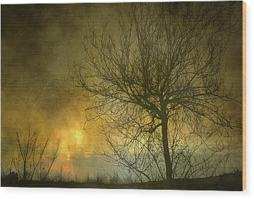 The Light Escapes Through The Clouds Wood Print by Guido Montanes Castillo