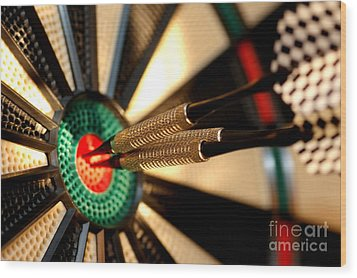 Three Arrows In The Centre Of A Dart Board Wood Print by Michal Bednarek