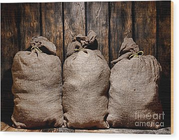 Three Bags In A Warehouse Wood Print by Olivier Le Queinec