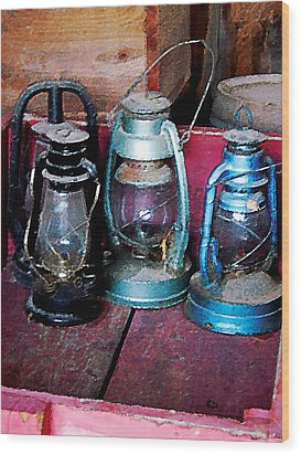 Three Kerosene Lamps Wood Print by Susan Savad