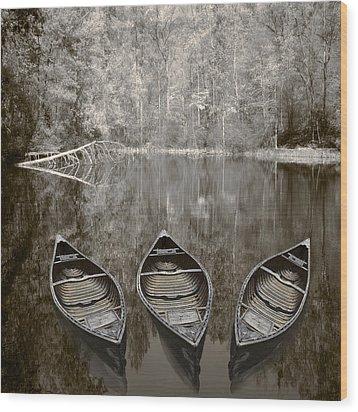 Three Old Canoes Wood Print by Debra and Dave Vanderlaan