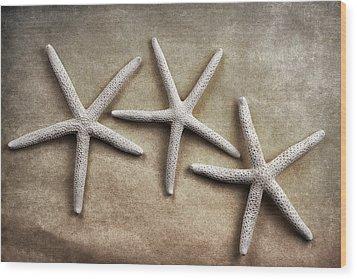 Three Starfish Wood Print by Carol Leigh