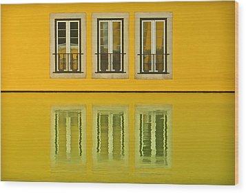 Three Windows Reflecting In The Water Wood Print
