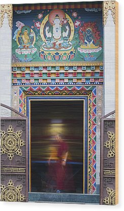 Tibetan Monk And The Prayer Wheel Wood Print by Tim Gainey