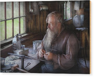 Tin Smith - Making Toys For Children Wood Print by Mike Savad