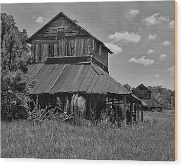 Tobacco Barns With Clouds Wood Print by Sandra Anderson