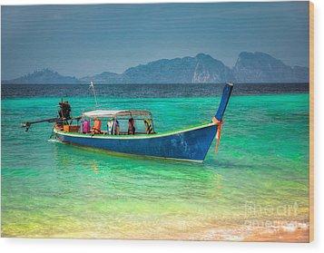 Tourist Longboat Wood Print by Adrian Evans