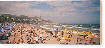 Tourists On The Beach, Sitges, Spain Wood Print by Panoramic Images