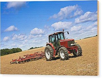 Tractor In Plowed Farm Field Wood Print by Elena Elisseeva