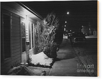 Traditional House With Porch Light Outside The Door And Snow Cleared Pavements At Night Delisle Sask Wood Print by Joe Fox