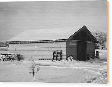 traditional wooden plank barn in rural village Forget Saskatchewan Canada Wood Print by Joe Fox