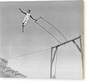 Trapeze Artist On The Swing Wood Print by Underwood Archives