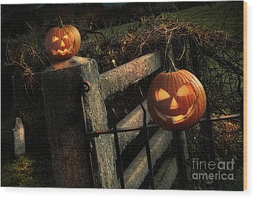 Two Halloween Pumpkins Sitting On Fence Wood Print