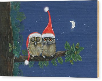 two little owls with Christmas caps Wood Print by Marina Durante