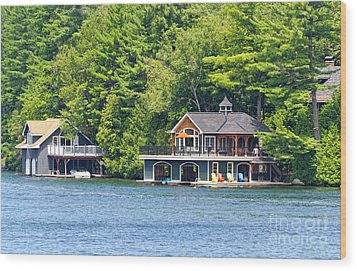 Two Luxury Boathouses Wood Print by Les Palenik