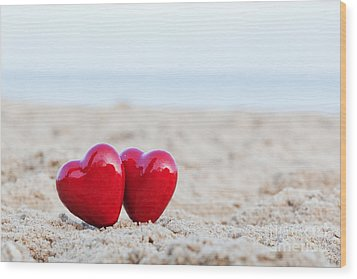 Two Red Hearts On The Beach Symbolizing Love Wood Print by Michal Bednarek