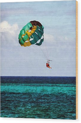 Two Women Parasailing In The Bahamas Wood Print by Susan Savad