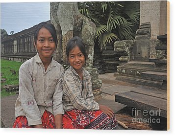 Two Young Cambodian Girls In Angkor Wat Wood Print by Sami Sarkis