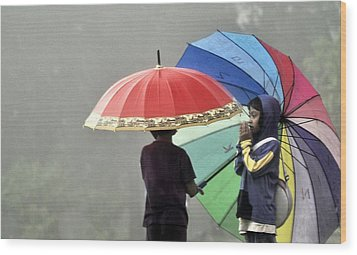 Umbrella For Rent Wood Print by Achmad Bachtiar