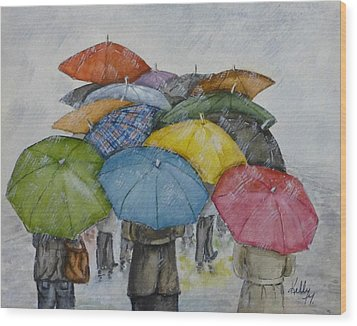 Umbrella Huddle Wood Print by Kelly Mills