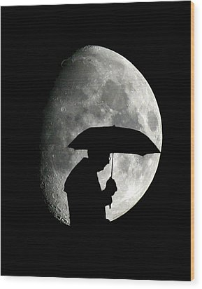 Umbrella Man With Moon Wood Print by Christopher McKenzie
