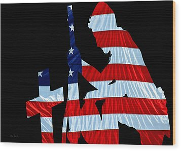 A Time To Remember United States Flag With Kneeling Soldier Silhouette Wood Print by Bob Orsillo