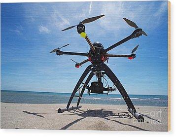 Unmanned Aerial Vehicle On Beach Wood Print by Sami Sarkis