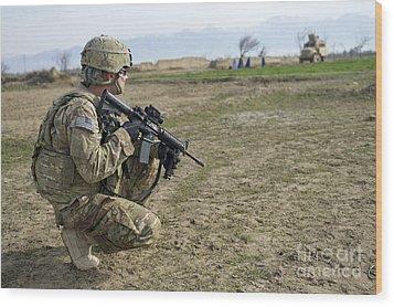 U.s. Soldier Patrols A Village Wood Print by Stocktrek Images