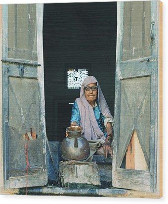 Varanasi Water Seller Wood Print by Shaun Higson
