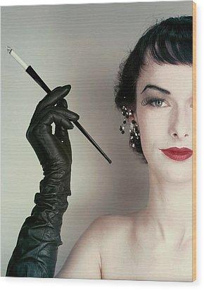 Victoria Von Hagen Holding A Cigarette Holder Wood Print by Erwin Blumenfeld