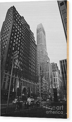 view of pennsylvania bldg nelson tower and US flags flying on 34th street from 1 penn plaza Wood Print by Joe Fox